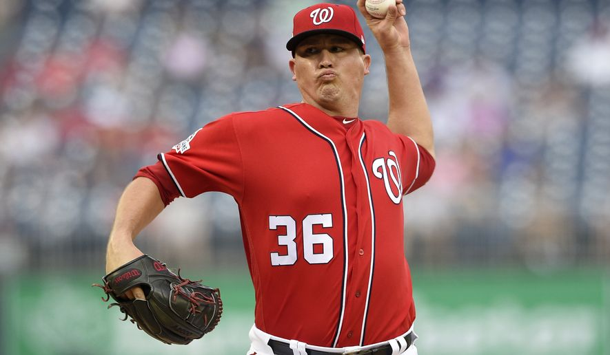 Washington Nationals relief pitcher Sammy Solis delivers a pitch during the sixth inning of the continuation of a suspended baseball game, Monday, June 18, 2018, in Washington. (AP Photo/Nick Wass)