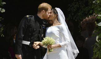 FILE - In this Saturday, May 19, 2018 file photo, Britain's Prince Harry and Meghan Markle leave after their wedding ceremony at St. George's Chapel in Windsor Castle in Windsor, near London, England. Thomas Markle, the father of the former Meghan Markle, said Monday June 18, 2018, he wishes he could have walked her down the aisle during her wedding to Prince Harry. (Ben Birchhall/pool photo via AP, File)