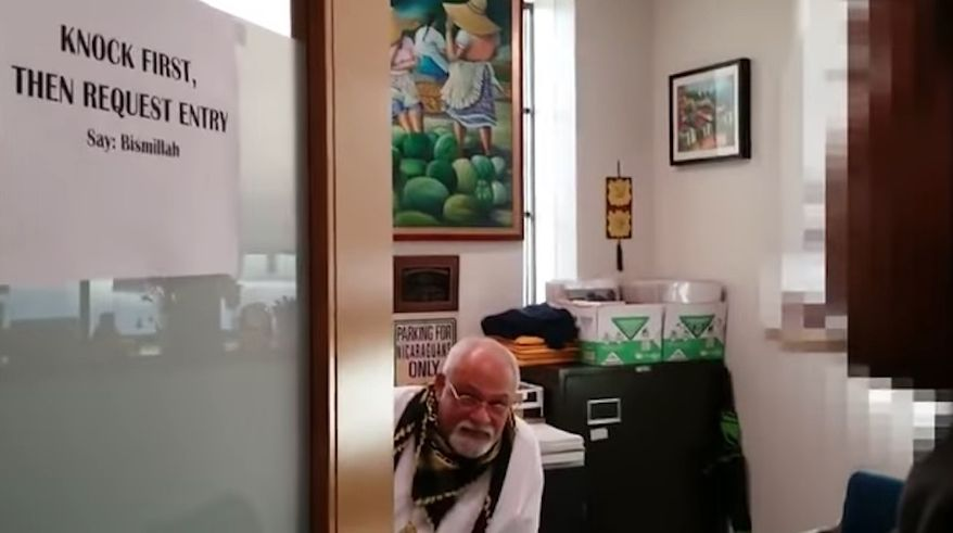 A newly retired Muslim professor at the University of Connecticut was caught on camera last year ordering students to remove their shoes and praise Allah before entering his office. (YouTube/@JihadWatchVideo)