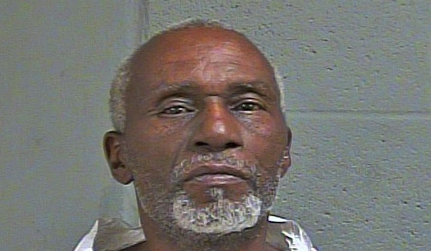 In this  June 17, 2018 booking photo provided by the Oklahoma County Sheriff's Office, Rufus E. Townsend, also known as Rufus Cudjo, is pictured. Townsend is in custody following the weekend death of a 56-year-old man in Oklahoma City. (Oklahoma County Sheriff's Office via AP)