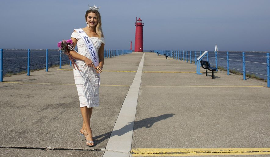 In this Sunday, June 17, 2018, photo, Miss Michigan 2018 Emily Sioma poses for a portrait in Muskegon, Michigan. The newly-crowned Miss Michigan plans to use her platform to support survivors of sexual assault. (Mike Krebs/Muskegon Chronicle via AP)