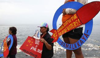 "Demonstrators continue to protest China over its coast guards' alleged seizure of fish caught by Filipino fishermen near the contested Scarborough Shoal in the South China Sea Thursday, June 14, 2018 by the baywalk in Manila, Philippines. The protesters denounced China's recent alleged harassment and assailed President Rodrigo Duterte for his ""sheer neglect to assert our legal and historic claim"" in the South China Sea. (AP Photo/Bullit Marquez)"