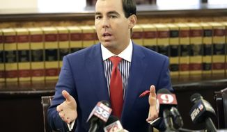 Matt Morgan, attorney for three passengers who were riding a Florida roller coaster when it derailed last week, speaks during a news conference Monday, June 18, 2018, in Orlando, Fla. Morgan said Monday that he has hired two ride-safety experts to evaluate what went wrong with the Sand Blaster roller coaster when it derailed last Thursday on the Daytona Beach Boardwalk. (AP Photo/John Raoux)