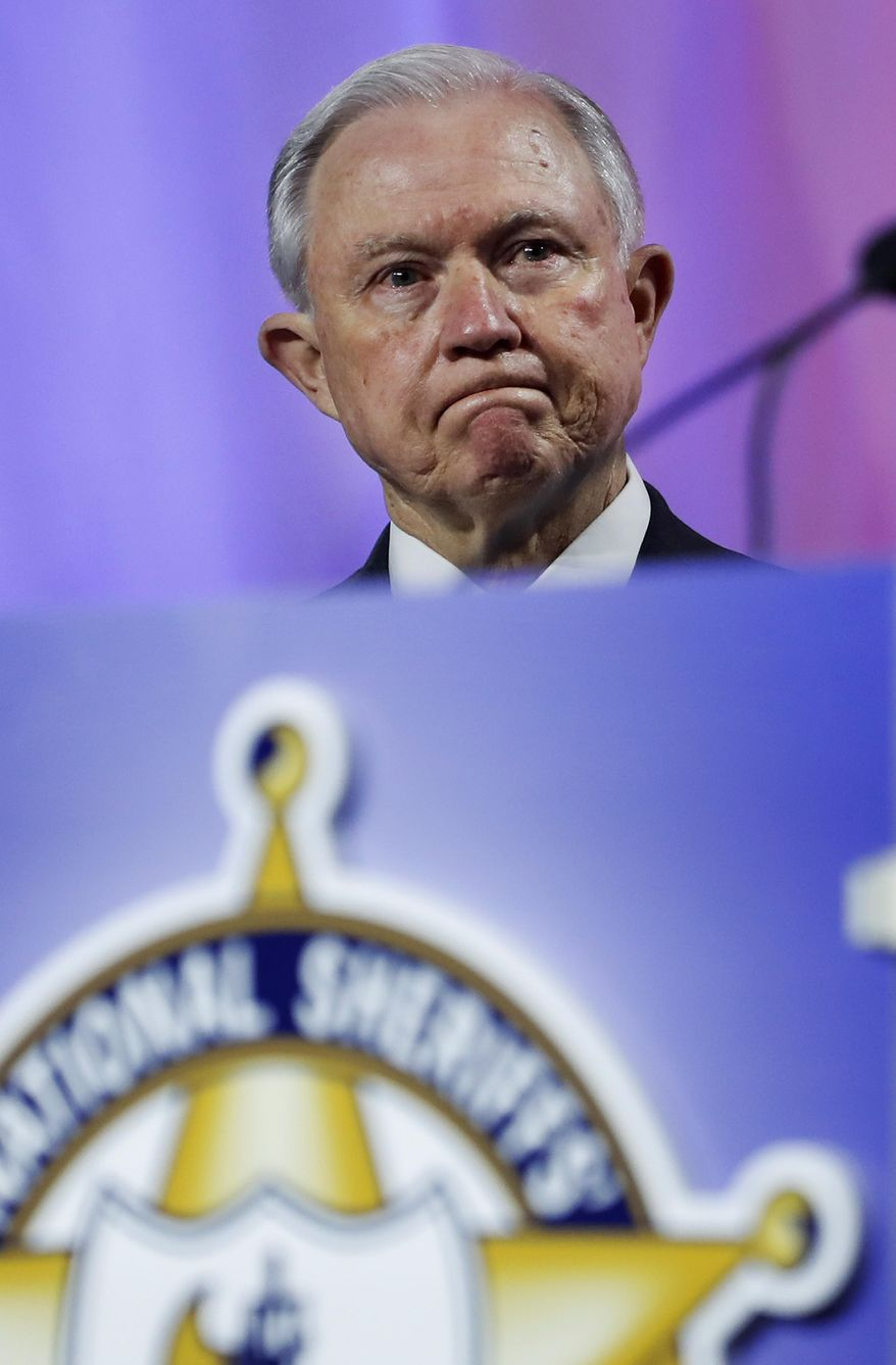 U.S. Attorney General Jeff Sessions listens as he is introduced to speak at the National Sheriffs' Association convention in New Orleans, Monday, June 18, 2018. (AP Photo/Gerald Herbert)