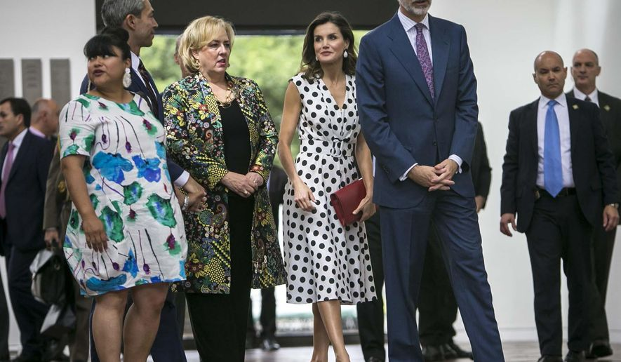 King Felipe the VI, right foreground, and Queen Letizia of Spain visit the San Antonio Museum of Art, Monday, June 18, 2018, in San Antonio. San Antonio Mayor Ron Nirenberg, second from left foreground, and wife Erika Prosper Nirenberg, left foreground, accompany the royals. (Josie Norris/The San Antonio Express-News via AP)