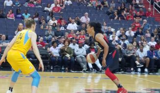 Kristi Toliver (right) of the Washington Mystics dribbles the ball against Allie Quigley of the Chicago Sky in a WNBA game at Capital One Arena in Washington, D.C., on Tuesday, June 19, 2018. (Adam Zielonka / The Washington Times)