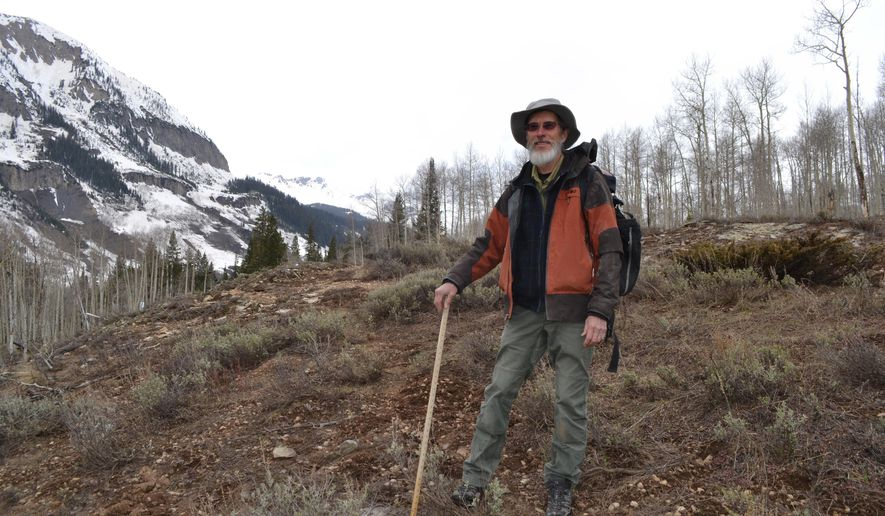 David Inouye poses for a photo in Gothic, Colo., in the Rocky Mountains area he studies on May 1, 2018. More than 40 years ago, the University of Maryland biologist started studying when wildflowers, birds, bees and butterflies first appeared each spring on this mountain. In 2018, plants and animals are arriving at the Rocky Mountain Biological Lab a week or two earlier than they were 30 years ago. The robins that used to arrive in early April ago now show up in mid-March. Marmots end their winter slumber ever earlier. (AP Photo/Peter Banda)