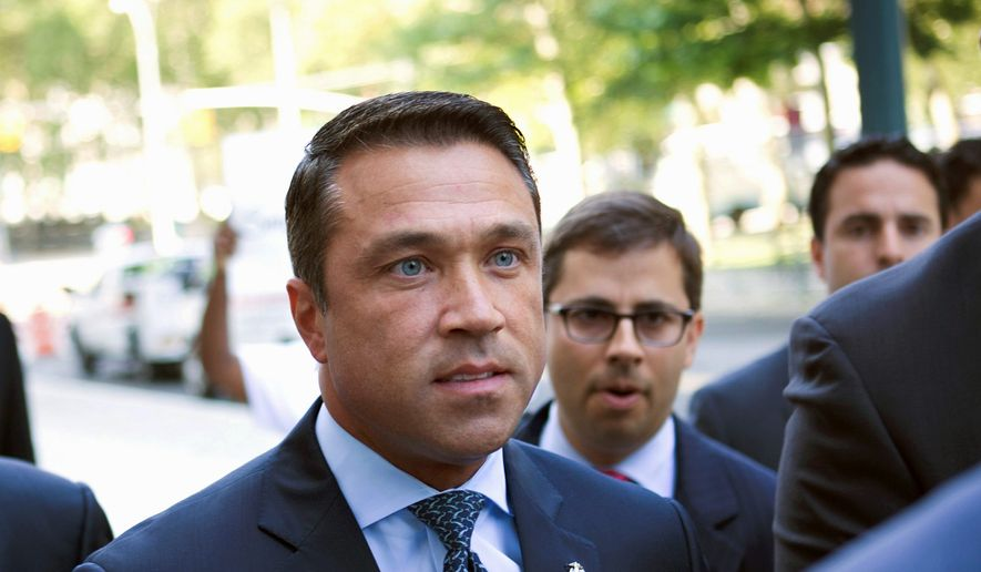 Former U.S. Rep. Michael Grimm has put behind him a checkered past to return to a rough and tumble brand of politics that made him a polarizing figure in New York's 11th Congressional district where he looks to unseat incumbent Rep. Dan Donovan. (Associated Press)