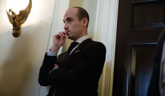 Senior White House adviser Stephen Miller listens as President Donald Trump speaks during a meeting with lawmakers on immigration policy in the Cabinet Room of the White House, Tuesday, Jan. 9, 2018, in Washington. (AP Photo/Evan Vucci)