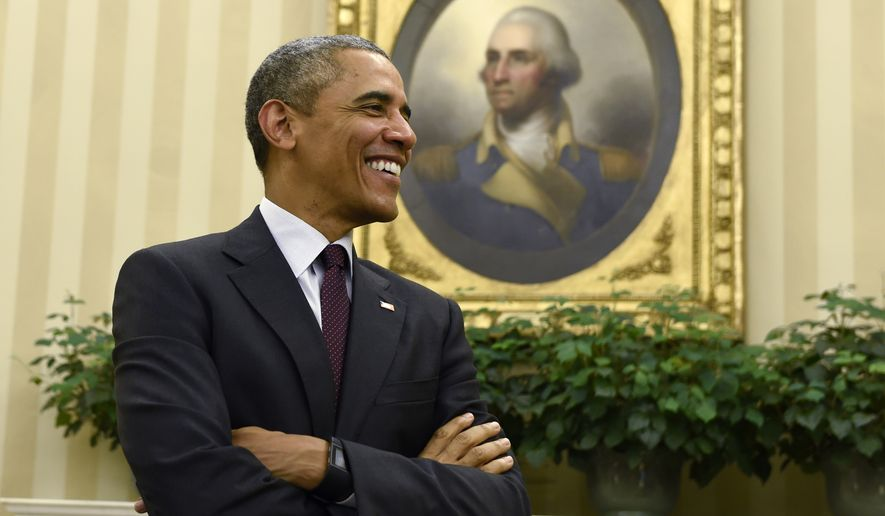 President Barack Obama smiles as he is asked a question following his meeting with United Nations Secretary-General Ban Ki-moon in the Oval Office at the White House in Washington, Tuesday, Aug. 4, 2015. (AP Photo/Susan Walsh)