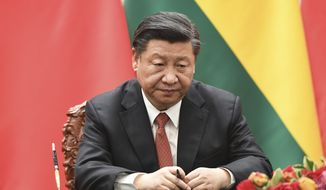 Chinese President Xi Jinping waits for his documents during a signing ceremony with Bolivia's President Evo Morales, at the Great Hall of the People in Beijing, Tuesday, June 19, 2018. (Greg Baker/Pool Photo via AP) ** FILE **