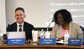 In this Monday, June 18, 2018 photo, Richmond City Schools Superintendent Jason Kamras, left and School Board Chair Dawn Page, right, listen during a Richmond School Board meeting in Richmond, Va. The Richmond School Board voted Monday to change the name of the city's final confederate leader-named school from J.E.B. Stuart to Barack Obama Elementary School. The vote was 6-1 in favor of the change. Richmond's new superintendent Jason Kamras was tapped by Barack Obama to serve as an education advisor to his 2008 presidential campaign. (Mark Gormus/Richmond Times-Dispatch via AP)