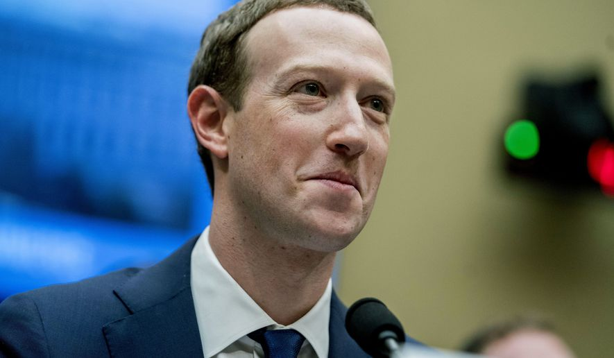 In this April 11, 2018, file photo, Facebook CEO Mark Zuckerberg pauses while testifying on Capitol Hill in Washington. (AP Photo/Andrew Harnik, File)