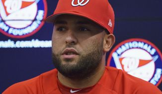 Newly acquired pitcher Kelvin Herrera, speaks to the media before a game against the Baltimore Orioles, Tuesday, June 19, 2018, in Washington. (AP Photo/Carolyn Kaster)