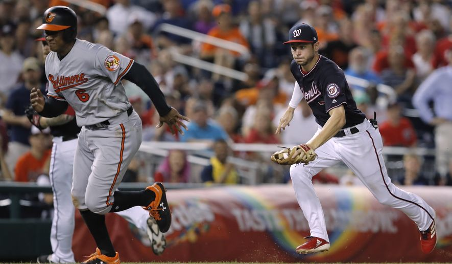 Washington Nationals shortstop Trea Turner, right, runs down Baltimore Orioles' Jonathan Schoop before making the tag for the out during the sixth inning of a baseball game at Nationals Park, Tuesday, June 19, 2018, in Washington. The Nationals won 9-7. (AP Photo/Carolyn Kaster) ** FILE **