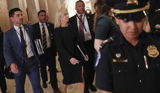 Homeland Security Secretary Kirstjen Nielsen, center, walks at the U.S. Capitol in Washington, after attending a meeting with President Donald Trump and members of the GOP leadership, Tuesday, June 19, 2018. (AP Photo/Pablo Martinez Monsivais)