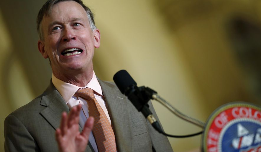 In this May 30,2018 file photo Colorado Gov. John Hickenlooper speaks at the state Capitol. On Tuesday, June 19, 2018, Hickenlooper ordered state regulators to adopt California's vehicle pollution rules, joining other states in resisting the Trump administration's plans to ease up on emissions standards. Hickenlooper, a Democrat, told regulators to try to have the new vehicle standards in place by the end of the year. (AP Photo/David Zalubowski,File)
