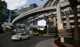 FILE - In this Jan. 14, 2016, photo, cars drive into the MGM Grand hotel and casino in Las Vegas. Thousands of unionized workers at Las Vegas casino-resorts operated by MGM Resorts International are set to approve their newly negotiated five-year contract. The agreement up for a vote Tuesday, June 19, 2018, includes wage increases and stronger protections against sexual harassment for 24,000 bartenders, housekeepers and other members of the Culinary Union. (AP Photo/John Locher, File)
