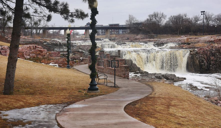This March 19, 2018 photo shows the Falls Park in Sioux Falls, S.D. City leaders are recommending a designated viewing area and more railings to improve safety at Falls Park following the drowning of a 5-year-old girl there in March. How to improve safety at the city's signature tour attraction has long been a difficult challenge. (Briana Sanchez/The Argus Leader via AP)