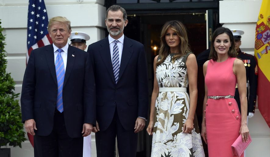President Donald Trump, left, poses for a photo with Spain's King Felipe VI, second from left, first lady Melania Trump, third from right, and Queen Letizia, right, on the South Lawn of the White House in Washington, Tuesday, June 19, 2018. (AP Photo/Susan Walsh) ** FILE **