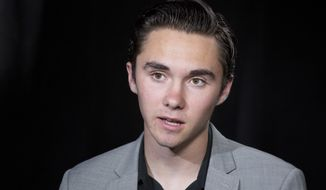 David Hogg, co-author of #NeverAgain, discusses the shooting at Marjory Stoneman Douglas High School during an interview in New York, Tuesday, June 19, 2018. Fourteen students and three staff members were fatally shot and multiple others wounded during the school massacre, on Feb. 14, 2018, in Parkland, Fla. (AP Photo/Mark Lennihan)