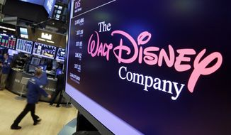 FILE - In this Aug. 8, 2017, file photo, The Walt Disney Co. logo appears on a screen above the floor of the New York Stock Exchange. Disney is making a $70.3 billion counter bid for Foxs entertainment businesses following Comcasts $65 billion offer for the company. (AP Photo/Richard Drew, File)
