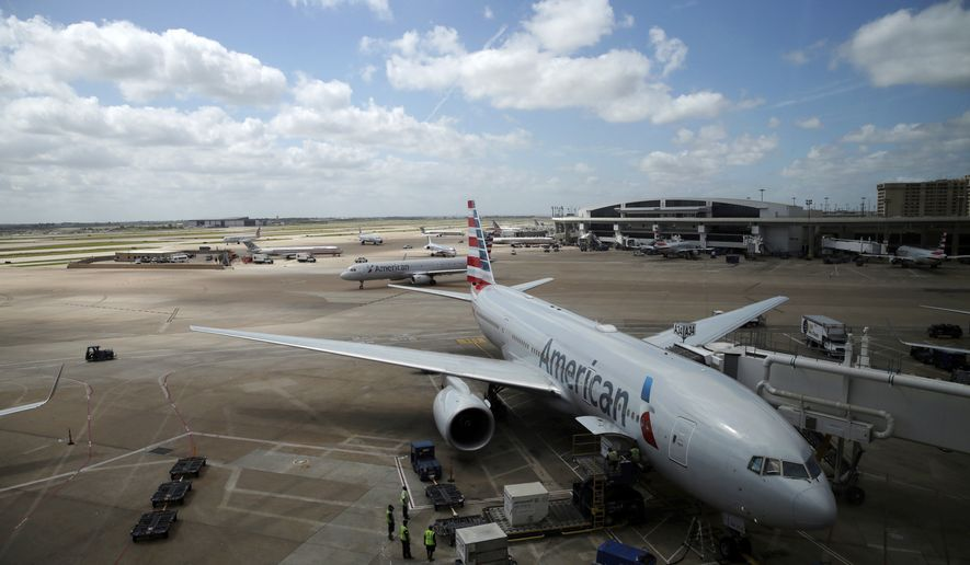 In this June 16, 2018, photo, American Airlines aircrafts are seen at Dallas-Fort Worth International Airport in Grapevine, Texas. American Airlines says it asked the Trump administration not to put migrant children who have been separated from their parents on its flights. In a statement Wednesday, June 20, American said it doesn't know whether any migrant children have been on its flights and doesn't want to profit from the current immigration policy of separating families. (AP Photo/Kiichiro Sato)