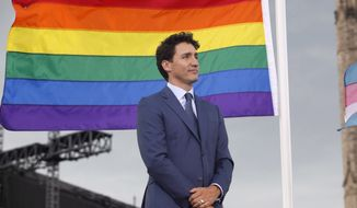 Prime Minister Justin Trudeau attends a pride flag raising ceremony on Parliament Hill in Ottawa on Wednesday, June 20, 2018. (Patrick Doyle/The Canadian Press via AP)