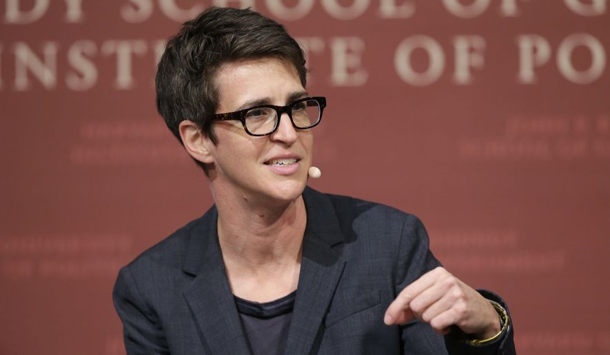 "In this Oct. 16, 2017, file photo, MSNBC television anchor Rachel Maddow, host of ""The Rachel Maddow Show,"" moderates a panel, at a forum called ""Perspectives on National Security,"" at the John F. Kennedy School of Government, on the campus of Harvard University, in Cambridge, Mass. Maddow broke down on her show live Tuesday evening, June 19, 2018, while trying to read an exclusive Associated Press story about babies and toddlers taken from their parents at the southern border and being sent to ""tender age"" shelters.  (AP Photo/Steven Senne, File)"