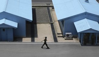 A North Korean soldier marches at the truce village at the Demilitarized Zone (DMZ) which separates the two Koreas in Panmunjom, North Korea, Wednesday, June 20, 2018. Since the summits between North Korean leader Kim Jong Un and the presidents of South Korea and the United States, things have quieted down noticeably in perhaps the most iconic symbol of the one last place on Earth where the Cold War still burns hot. (AP Photo/Dita Alangkara)
