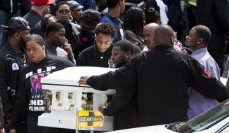 In this May 5, 2014 photo, the casket of Endia Martin is carried by pallbearers following funeral services for 14-year-old at St. Andrew Temple Baptist Church in Chicago. Martin was killed by another 14-year-old in what started as a Facebook feud over a boy. Sentencing is scheduled on Wednesday, June 20, 2018, in juvenile court for the teen who pleaded guilty in the death of Martin in January. Under the law she faces a mandatory sentence of five years in custody, or until the age of 21. The teen, who is now 18, can be paroled when she turns 19 next month.  (Jessica Koscielniak/Chicago Sun-Times via AP)
