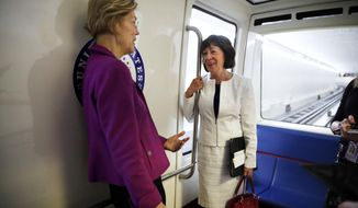 Sen. Elizabeth Warren, D-Mass., left, and Sen. Susan Collins, R-Maine, ride the Senate subway as they head to a vote on Capitol Hill, Wednesday, June 20, 2018 in Washington. (AP Photo/Jacquelyn Martin)