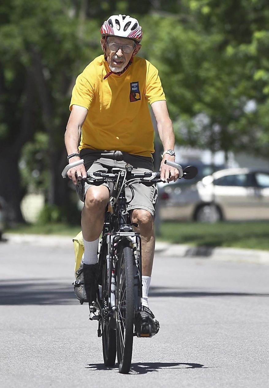 In a Wednesday, June 13, 2018 photo, Mankato bike advocate Richard Keir takes a spin around his neighborhood. The 82-year-old has been a key figure in making Mankto a more bike-friendly community. (Pat Christman/The Free Press via AP)