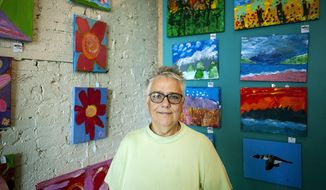 In this Tuesday, June 12, 2018 photo, Deborah Blackwell poses in her art studio, in Janesville, Wis. Blackwell is the executive director of Studio 84 in Whitewater, Wis. (Angela Major/The Janesville Gazette via AP)
