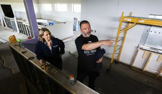 In a Friday, June 8, 2018 photo, Dawn, left, and Steve Finnie talk about the new Little Thistle Brewing Company taproom, in Rochester, Minn. (Andrew Link/The Rochester Post-Bulletin via AP)
