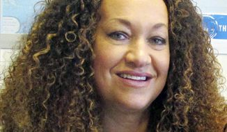 FILE - In this March 20, 2017, file photo, Nkechi Diallo, then known as Rachel Dolezal, poses for a photo in Spokane, Wash. A court hearing is scheduled Wednesday, June 20, 2018, Diallo, whose life unraveled after she was exposed as a white woman pretending to be black. Diallo, pleaded not guilty through her attorney to charges including welfare fraud. (AP Photo/Nicholas K. Geranios, File)