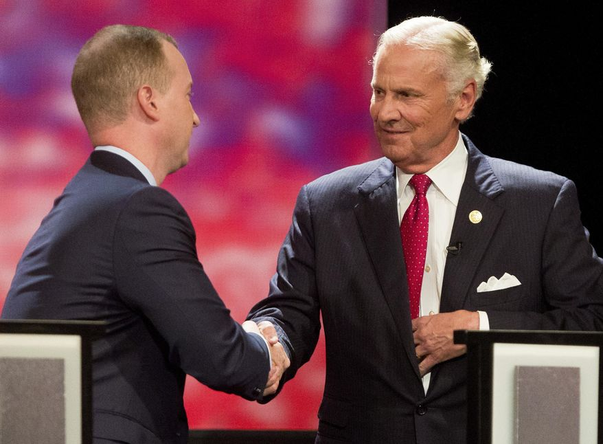 Republican governor candidates participate in a gubernatorial between challenger John Warren and Governor Henry McMaster Wednesday, June 20, 2018, at Newberry Opera House in Newberry, S. C. (Andrew Whitaker/The Post And Courier via AP)