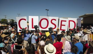 Protesters stand outside the U.S. Immigration and Customs Enforcement processing center in El Paso, Texas, Tuesday, June 19, 2018. (Ivan Pierre Aguirre/The San Antonio Express-News via AP)