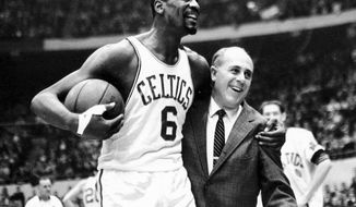 "FILE - In this Dec. 12, 1964, file photo, Boston Celtics' Bill Russell, left, is congratulated by coach Arnold ""Red"" Auerbach after scoring his 10,000th career point during an NBA basketball game against the Baltimore Bullets at the Boston Garden in Boston. Russell was a No. 2 pick in the NBA draft. (AP Photo, File)"