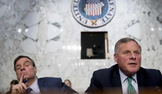 In this file photo, Senate Intelligence Chairman Richard Burr, R-N.C., right, accompanied by Committee Vice Chairman Mark Warner, D-Va., left, speaks during a Senate Intelligence Committee hearing on 'Policy Response to Russian Interference in the 2016 U.S. Elections' on Capitol Hill, Wednesday, June 20, 2018, in Washington. (AP Photo/Andrew Harnik) **FILE**