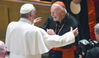 FILE - In this Sept. 23, 2015 file photo, Pope Francis reaches out to hug Cardinal Archbishop emeritus Theodore McCarrick after the Midday Prayer of the Divine with more than 300 U.S. Bishops at the Cathedral of St. Matthew the Apostle in Washington. The retired archbishop of Washington, D.C. has been removed from public ministry over allegations he sexually abused a teenager while a priest in New York more than 40 years ago. (Jonathan Newton / The Washington Post via AP, Pool, File)