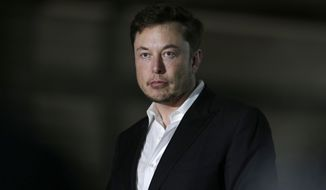 In this June 14, 2018, file photo, Tesla CEO and founder of the Boring Company Elon Musk speaks at a news conference in Chicago. (AP Photo/Kiichiro Sato)