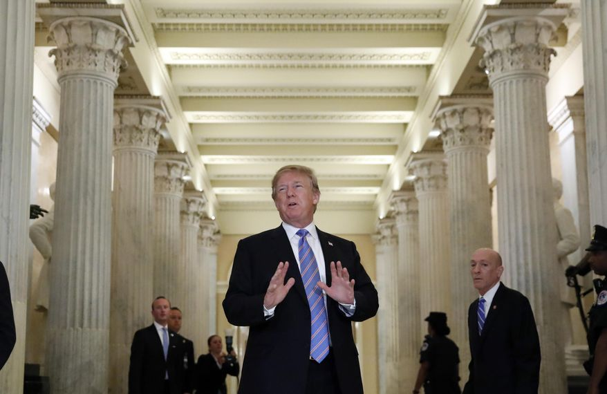 President Donald Trump speaks in the Hall of Columns as he arrives on Capitol Hill in Washington, Tuesday, June 19, 2018, to rally Republicans around a GOP immigration bill. However Republicans on Capitol Hill, mindful of the country's spreading outrage over separating families at the border, have been frantically searching for ways to end the Trump administration's policy. (AP Photo/Alex Brandon)