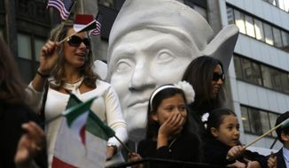 In this Oct. 12, 2015, file photo, participants in the Columbus Day Parade ride a float with a large bust of Christopher Columbus in New York. A movement to abolish Columbus Day and replace it with Indigenous Peoples Day has new momentum but the gesture to recognize victims of European colonialism has also prompted howls of outrage from some Italian Americans, who say eliminating their festival of ethnic pride is culturally insensitive, too. (Associated Press) **FILE**