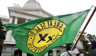 A flag of of the state of Jefferson flutters in the wind during a rally calling for the creation of the 51st state at the state Capitol, Wednesday, Jan. 6, 2016, in Sacramento, Calif. (AP Photo/Rich Pedroncelli)