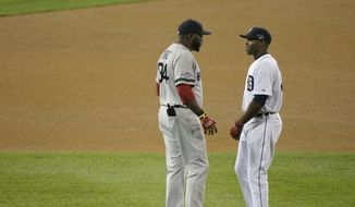 Boston Red Sox's David Ortiz talks with Detroit Tigers' Torii Hunter before Game 4 of the American League baseball championship series Wednesday, Oct. 16, 2013, in Detroit. (AP Photo/Charlie Riedel) **FILE**