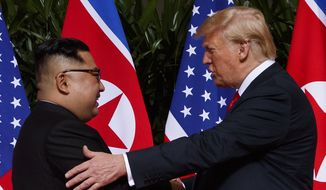 In this Tuesday, June 12, 2018, file photo, U.S. President Donald Trump meets with North Korean leader Kim Jong-un on Sentosa Island in Singapore. (AP Photo/Evan Vucci, File)