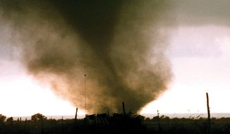 A tornado cuts across the ground near Jarrell, Texas, Tuesday, afternoon, May 27, 1997. At least 30 people were killed and scores more injured as several tornadoes cut a swath through at least three Central Texas Counties. (AP Photo/Theresa Schuch)
