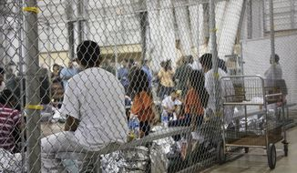 "In this photo provided by U.S. Customs and Border Protection, people who've been taken into custody related to cases of illegal entry into the United States, sit in one of the cages at a facility in McAllen, Texas, Sunday, June 17, 2018. More than 2,300 minors have been separated from their parents since April, when the Trump administration launched its ""zero-tolerance"" policy that called for prosecuting illegal immigrants and taking their children away. (U.S. Customs and Border Protection's Rio Grande Valley Sector via AP)"