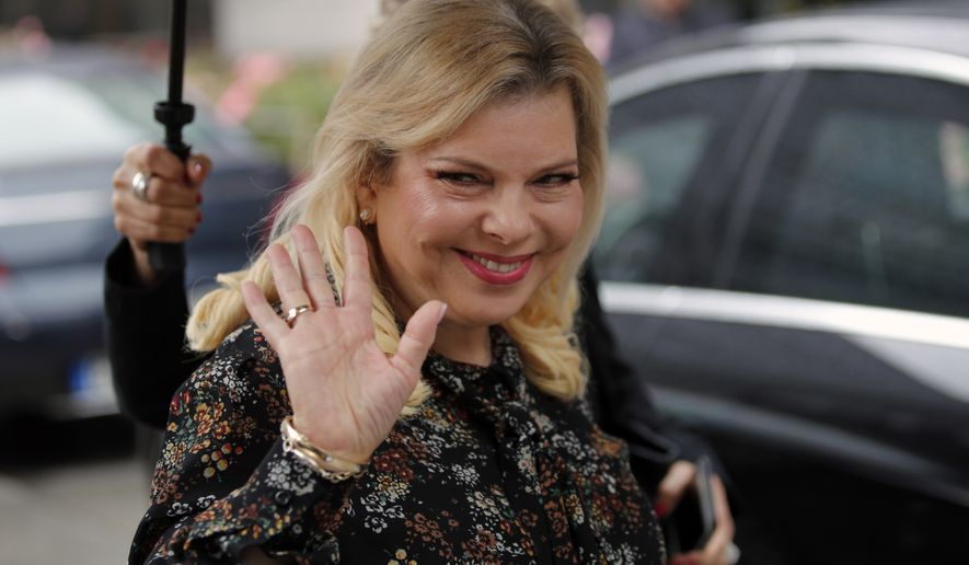 In this Wednesday, June 6, 2018, file photo, Israel's Prime Minister's wife Sara Netanyahu arrives for the meeting with French Finance Minister Bruno Le Maire at Bercy Economy Ministry, in Paris, France. Israeli prosecutors have charged Sara Netanyahu, the prime minister's wife, with a series of crimes including fraud and breach of trust. (AP Photo/Francois Mori, File)